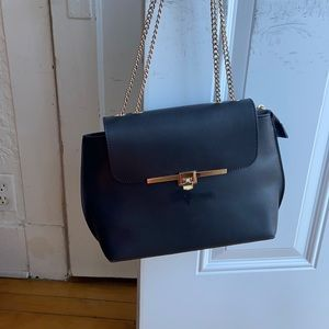 Genuine black leather bag with gold chain italy